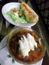 Vegetable soup with cod and stuffed courgette